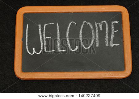 Blackboard with the word welcome written on it