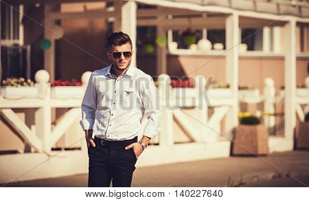 portrait of a serious young man in the city