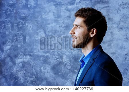 Profile portrait of a handsome man wearing elegant suit. Men's beauty, fashion. Businessman.