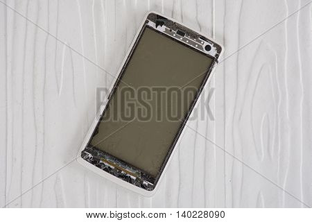 Smartphone screens are damaged on white pattern background suitable background used product.