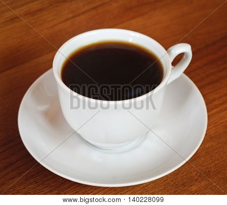 One cup of coffee on a wooden table