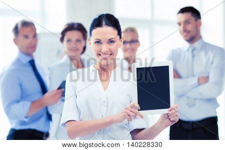 picture of smiling businesswoman with tablet pc in office