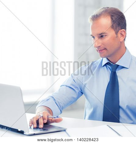 picture of smiling businessman working in office