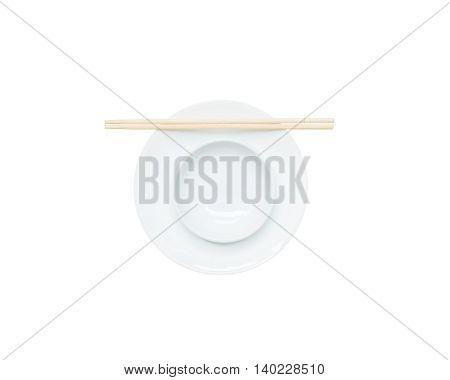 Closeup white ceramic chalice on circle dish wood chopsticks isolated on white background