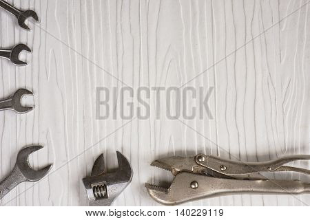 Wrench and locking pliers on white pattern background.Background craftsman tool or background construction or background masonry