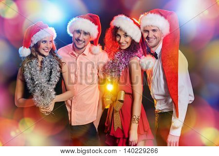 Cheerful young people celebrating Christmas together. Holidays, celebration.