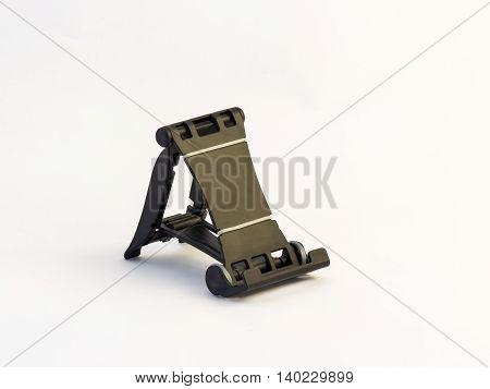 Folding black plastic holder for mobile phone on a white background