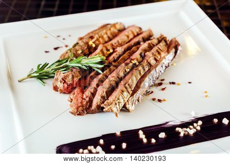 tasty steak with sauce