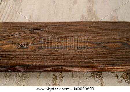 vintage cutting board with space for text on white wooden background close-up