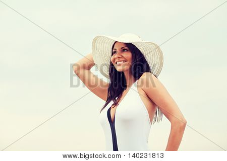 summer vacation, tourism, travel, holidays and people concept -face of happy young woman on beach