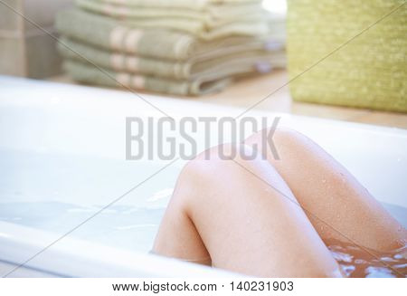 Wet knees of the woman taking a bath