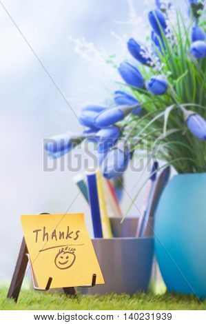 Adhesive note with Thanks text at green office