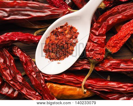 Dried chilies with chili flakes on a spoon