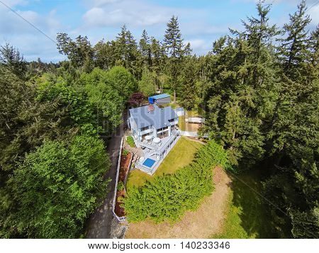 Panoramic View Of Marine Style House In The Woods.