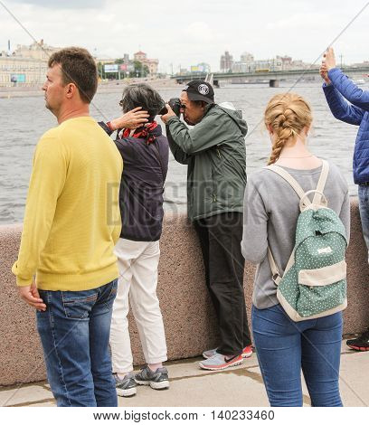 St. Petersburg, Russia - 16 July, Elderly tourist photographs on the waterfront, 16 July, 2016. Statement of the legendary cruiser