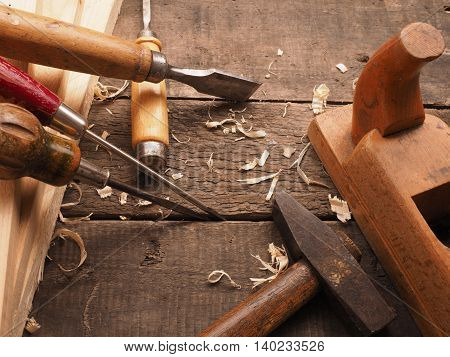 Old used carpenter tools on a workbench