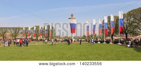 St. Petersburg, Russia - 9 May, Exchange Square with flags. 2016. Vacationers people on the lawns and gardens in the city.