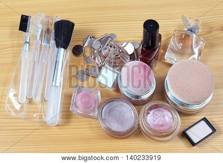 Beauty pink make up with face brushes and other accessories