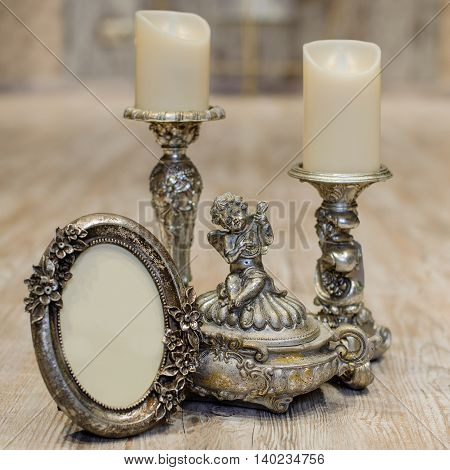 image of vintage antique classical frame and candles on wooden table