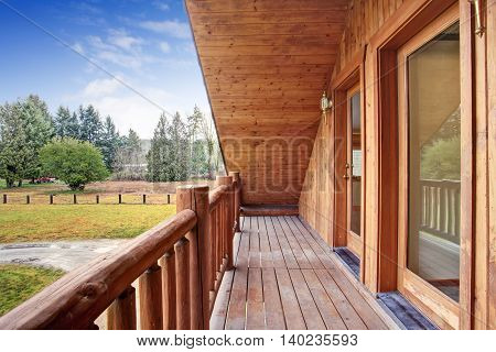 American Log Cabin House Exterior. Landscape View From The Balcony.