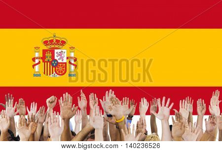 Spain National Flag People Hand Raised Concept