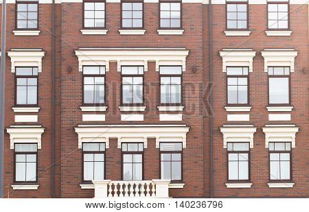 Town house in a flat style with square windows.