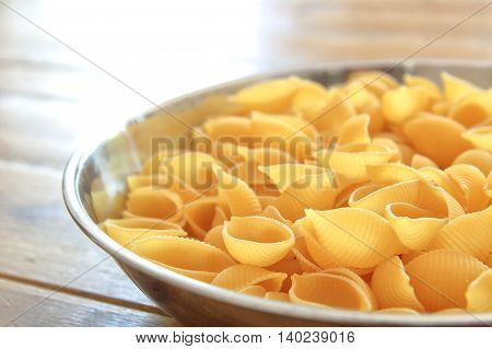 Dry Conchiglie Pasta Shells In A Stainless Steel Bowl