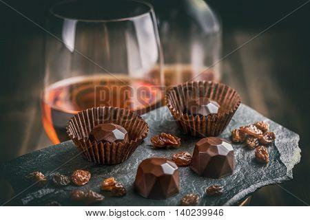 Delicious chocolate pralines on black background, studio shot