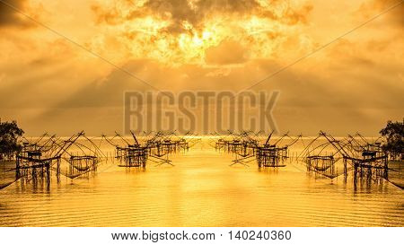 Fisherman tool with sunrisewith orange sky at Pakpra Phatthalung Thailand