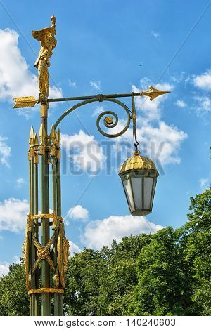 St.Petersburg historical street lantern over cloudy sky