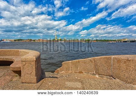 The granite embankment of the river Neva and Peter and Paul Fortress at summer day St.Petersburg Russia