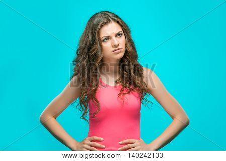 The portrait of disaffected woman on blue background