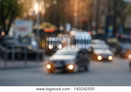 car driving on evening city street. blurred focus.