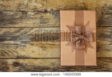 brown gift box on old wooden table retro style