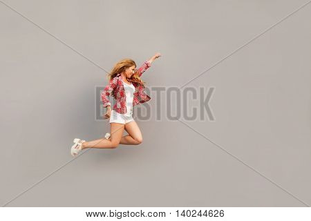 Girl jumping up with the leader of the outstretched hand