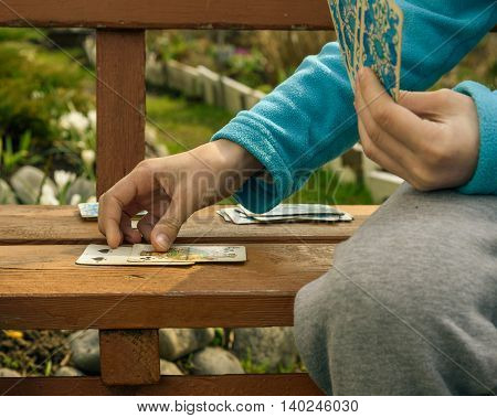Hands Of Children And Playing Cards