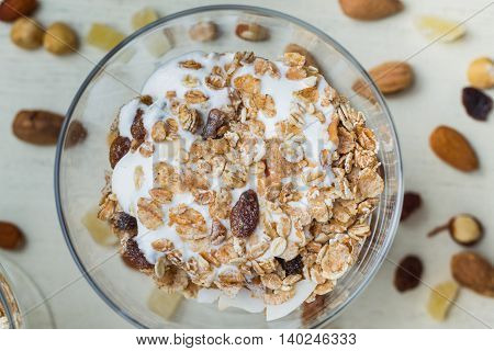 Granola With Yogurt, Nuts And Fruits In Glass Bowl On Light Background. Delicious, Healthy Sweet Des