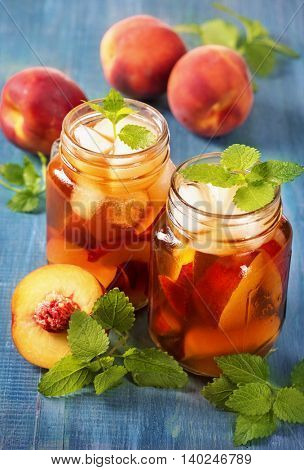 Peach iced tea in glass jars