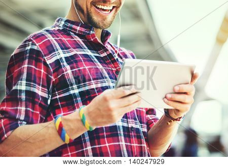 Guy Smiling Watching Tablet Outdoors Concept