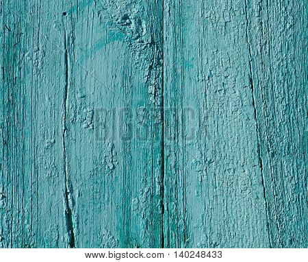 Grunge rusty wall background. Old emerald green painted wall. Abandoned building and fragment of old wall. Bright color old age wall. Colorful background