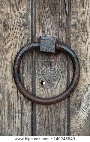 Close-up view of an ancient door knocker ring