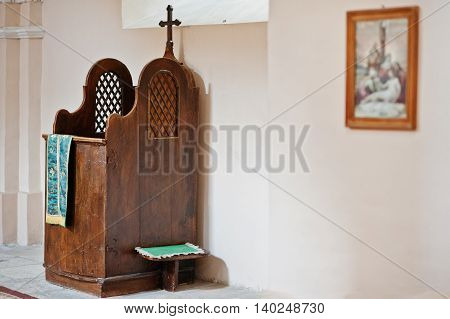 Wooden Brown Confessional Box With Cross At Church