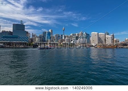 SYDNEY, AUSTRALIA - APRIL, 2016 : View of Tall Ship HMB Endeavour, ferries, cruises, ships, tall buidings at Darling Harbour in Sydney, Australia on April 21, 2016.