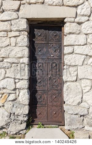 Front view of an ancient metal door
