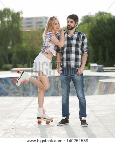 Young happy couple having great quality time in the park.