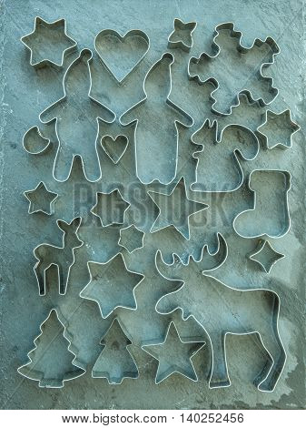 Rustic christmas background with vintage cookie cutters