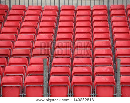 Closeup on Concert Spectator Steel Platform with Rows of Red Plastic Seats