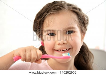 Cute little girl with toothbrush, close up