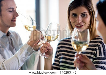 Happy young friends drinking wine at restaurant