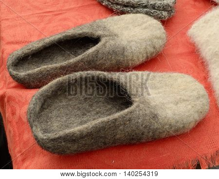 Warm felt shoes are very useful in the winter when it's cold.